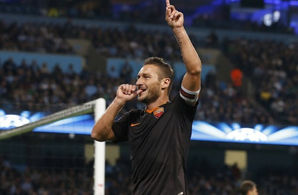 as-romas-totti-celebrates-scoring-a-goal-against-manchester-city-during-their-champions-league-soccer-match-at-the-etihad-stadium-in-manchester